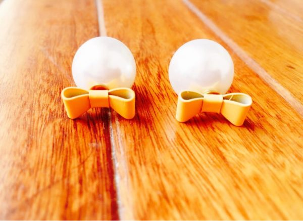 Two-way-stud-earrings-with-big-pearl-and-bow